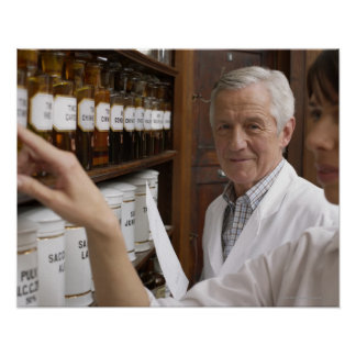 Two pharmacists in front of a shelf with tins poster