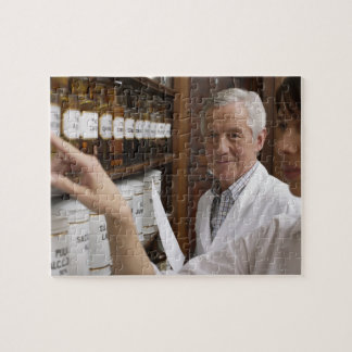 Two pharmacists in front of a shelf with tins jigsaw puzzle