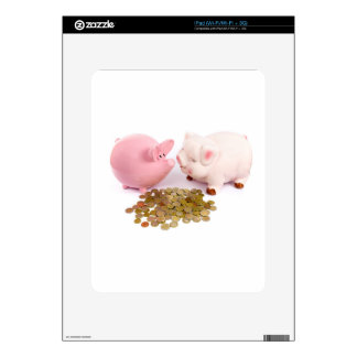Two piggy banks with euro coins on white iPad skins