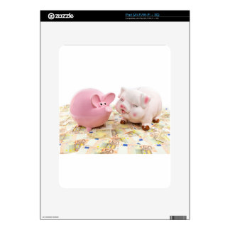 Two pink piggy banks on spread euro notes iPad skin