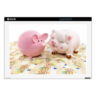 Two pink piggy banks on spread euro notes laptop skin