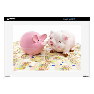"Two pink piggy banks on spread euro notes skins for 15"" laptops"