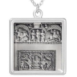 Two plaques from a chest silver plated necklace