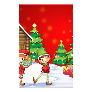 Two playful dwarves near the christmas trees stationery