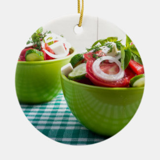 Two portions of useful vegetarian meal ceramic ornament