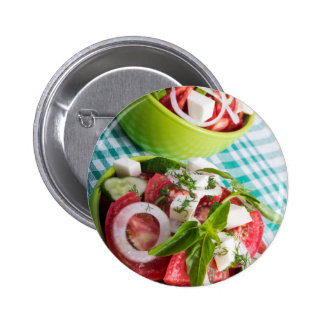 Two portions of useful vegetarian meal closeup button