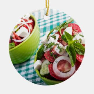 Two portions of useful vegetarian meal closeup ceramic ornament