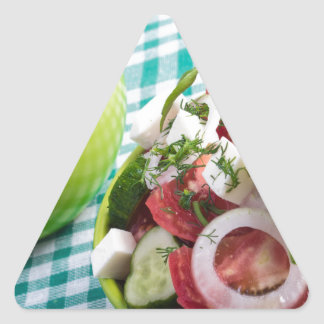 Two portions of useful vegetarian meal closeup triangle sticker