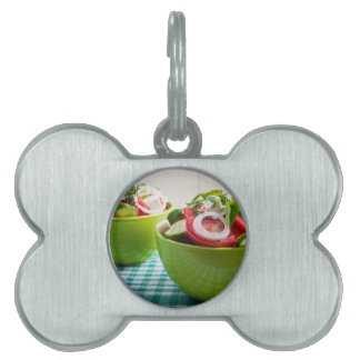 Two portions of useful vegetarian meal pet tag