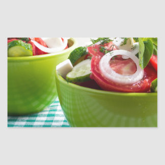 Two portions of useful vegetarian meal rectangular sticker