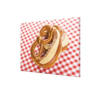 Two pretzel on checkered tablecloth canvas print