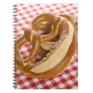 Two pretzel on checkered tablecloth notebook