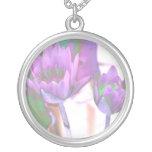 two purple water lilies invert solarized pendants