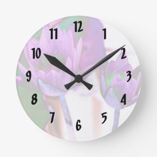 two purple water lilies invert solarized round clock