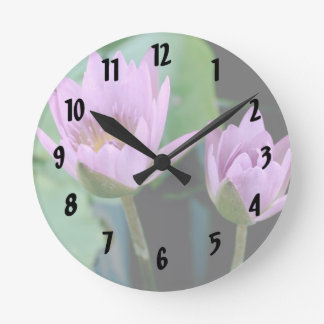 two purple water lilies round clock