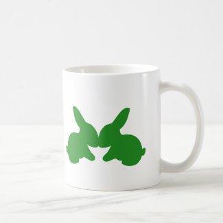 Two rabbits kissing on a coffee mug