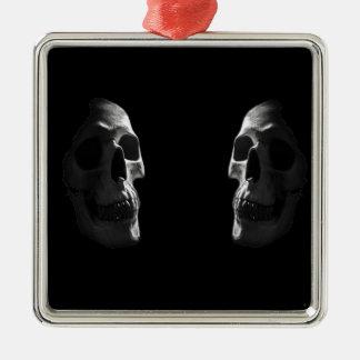 Two real smiling skulls metal ornament