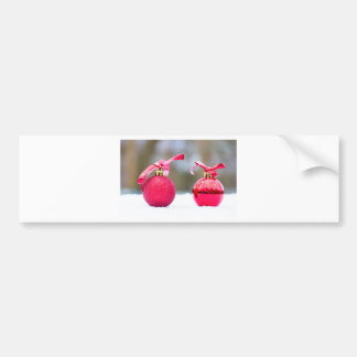 Two red christmas balls outside in snow bumper sticker