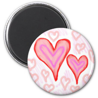Two red pink purple hearts surrounded by small refrigerator magnets