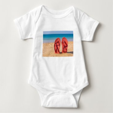 Beach Themed Two red slippers upright in sand of beach.JPG Baby Bodysuit