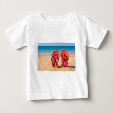 Beach Themed Two red slippers upright in sand of beach.JPG Baby T-Shirt