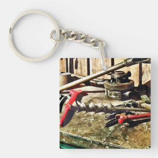 Two Red Wrenches on Plumber's Workbench Keychain