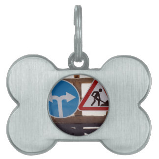 Two road signs low wooden stand pet name tag