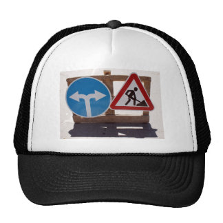 Two road signs low wooden stand trucker hat