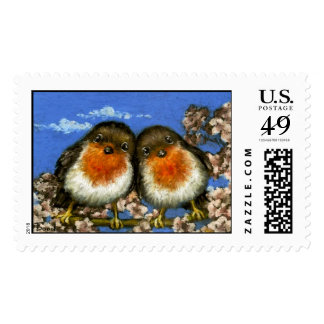 Two robins singing love songs in cherry blossom stamp