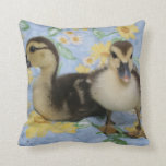 two rouen ducklings against flowered background pillows