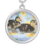 two rouen ducklings facing right one standing jewelry