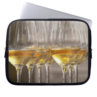 two rows of wine tasting glasses with lucious computer sleeve