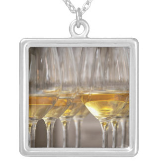 two rows of wine tasting glasses with lucious square pendant necklace