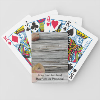 two seagrape leaves wooden dock bicycle playing cards