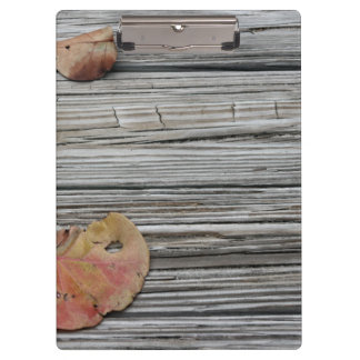 two seagrape leaves wooden dock clipboard