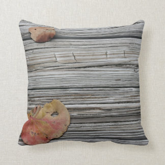 two seagrape leaves wooden dock pillows
