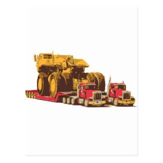 Two Semi Big Trucks carrying a Huge Mining Truck Post Card