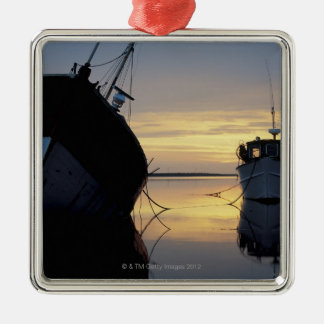 two ships anchored at sunset metal ornament
