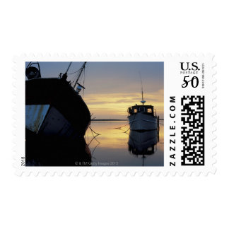 two ships anchored at sunset postage