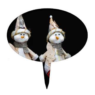 Two snowmen figurines with red baubles on black cake topper