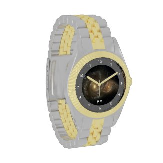 This gold and silver two tone wristwatch features two spiral galaxies with thousands of stars of different ages, sizes and colors intertwining and colliding in swirling clouds of interstellar gas and dust. Add your initials or monogram to personalize.