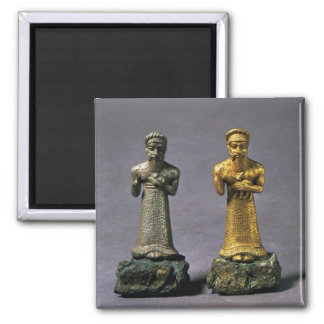 Two statuettes of men carrying offerings of goats, 2 inch square magnet