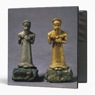 Two statuettes of men carrying offerings of goats, binders