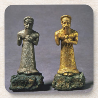 Two statuettes of men carrying offerings of goats, coaster