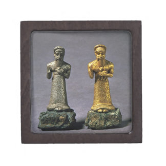 Two statuettes of men carrying offerings of goats, gift box