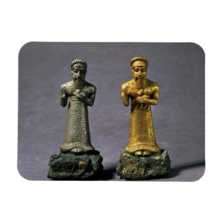 Two statuettes of men carrying offerings of goats, magnet