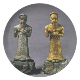 Two statuettes of men carrying offerings of goats, melamine plate