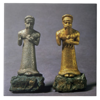 Two statuettes of men carrying offerings of goats, tile
