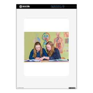 Two students learning with books in biology lesson decal for the iPad