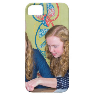Two students learning with books in biology lesson iPhone SE/5/5s case
